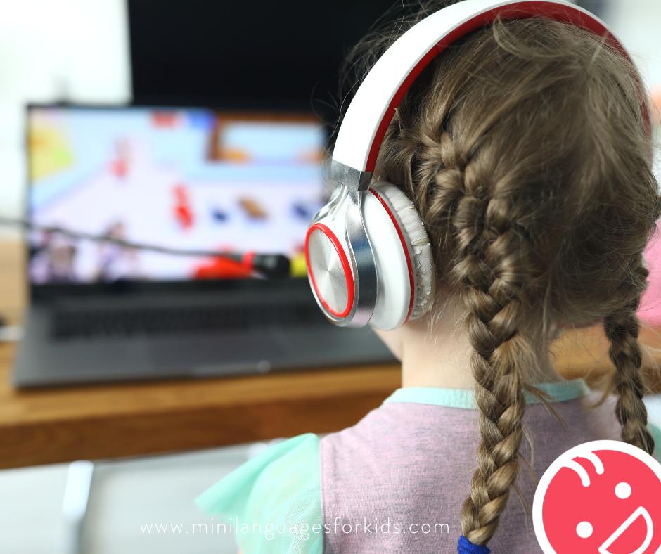 Girl watching laptop Online French Tutor